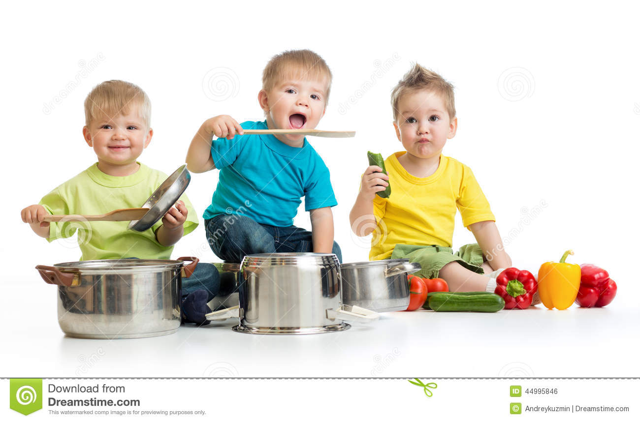 Kids group cooking on white. Three boys are playing wit