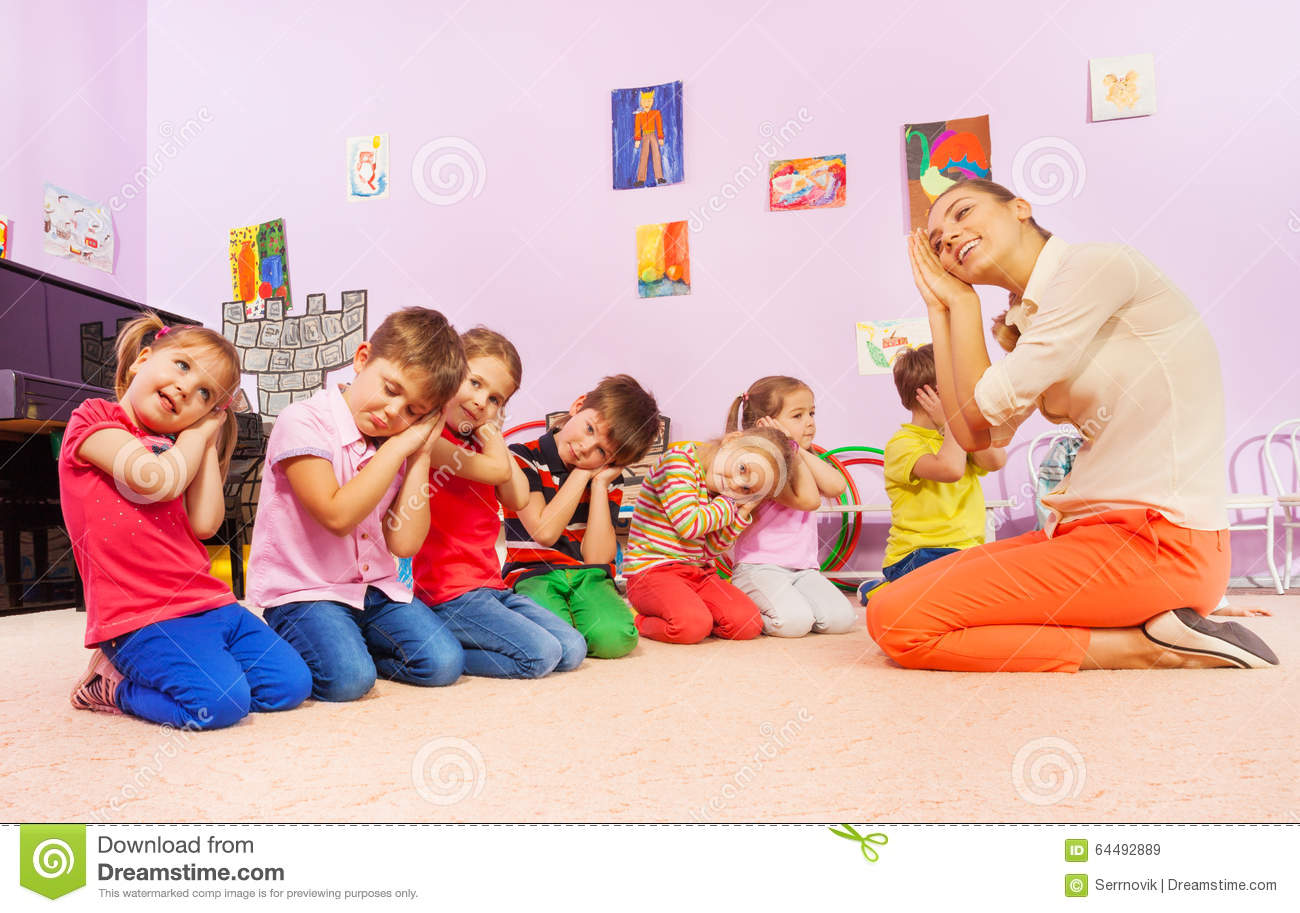 kids in group play game pretending to sleep stock image image of