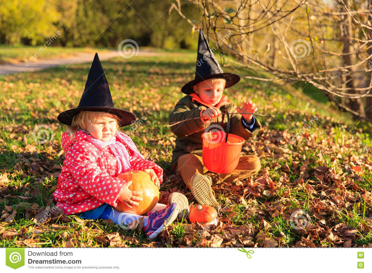 kids in halloween costume play at autumn park