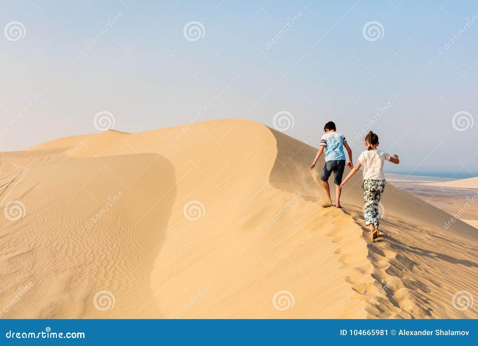 Kids having fun at desert stock image  Image of emotion