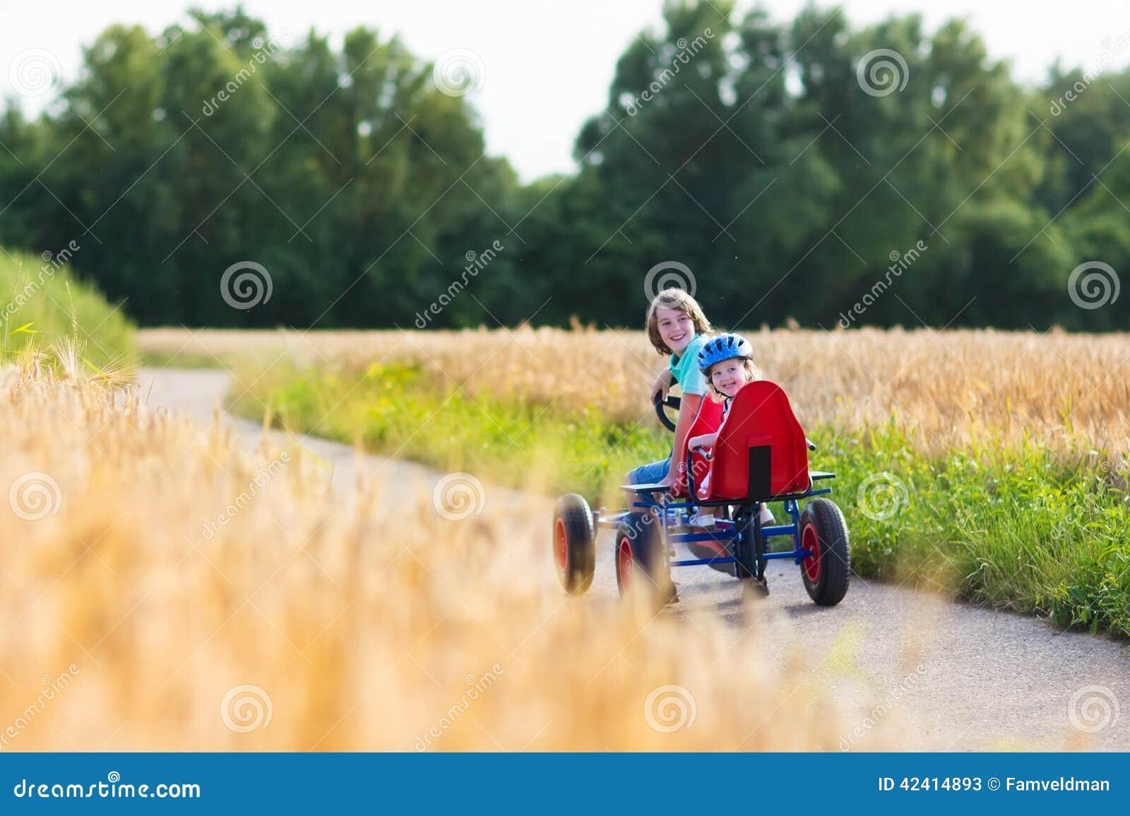 Kids having fun with a go cart car