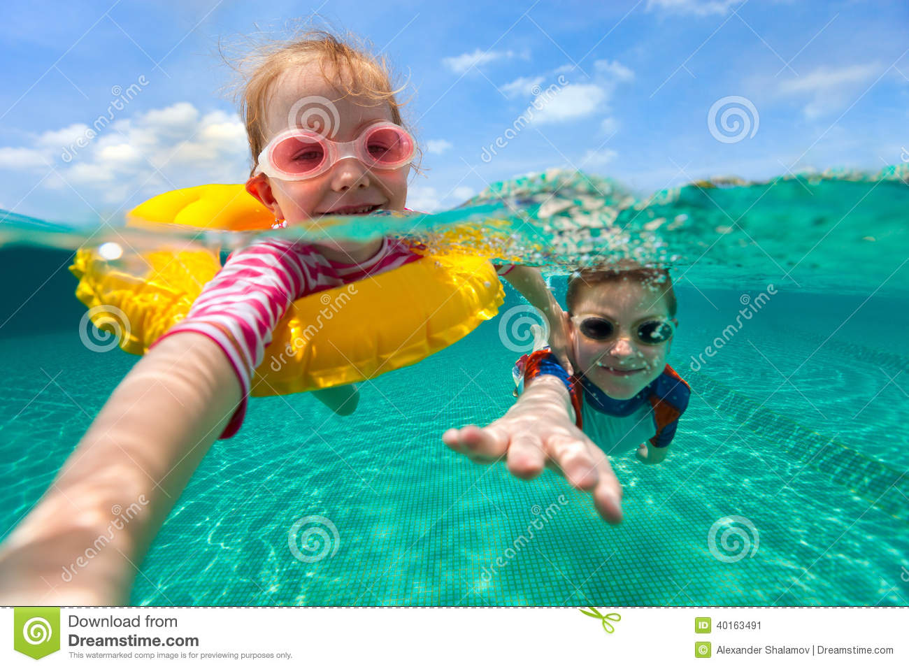 Kids having fun swimming on summer vacation
