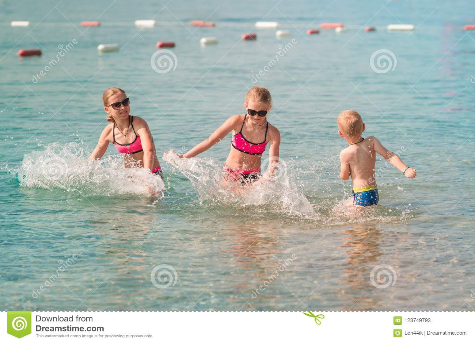 Kids having fun in the water at the seaside