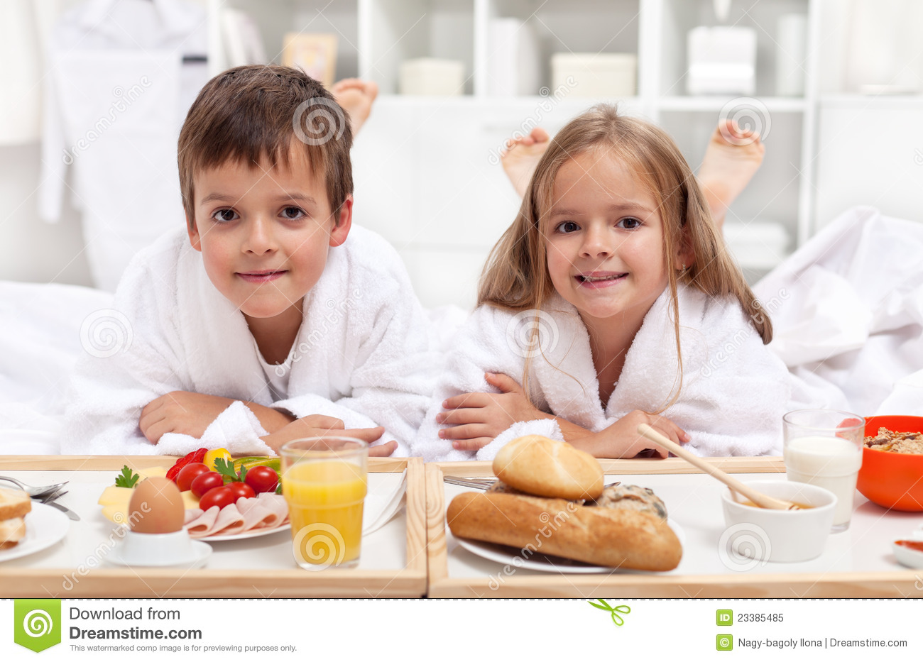 Kids Having A Healthy Breakfast In Bed Royalty Free Stock ...