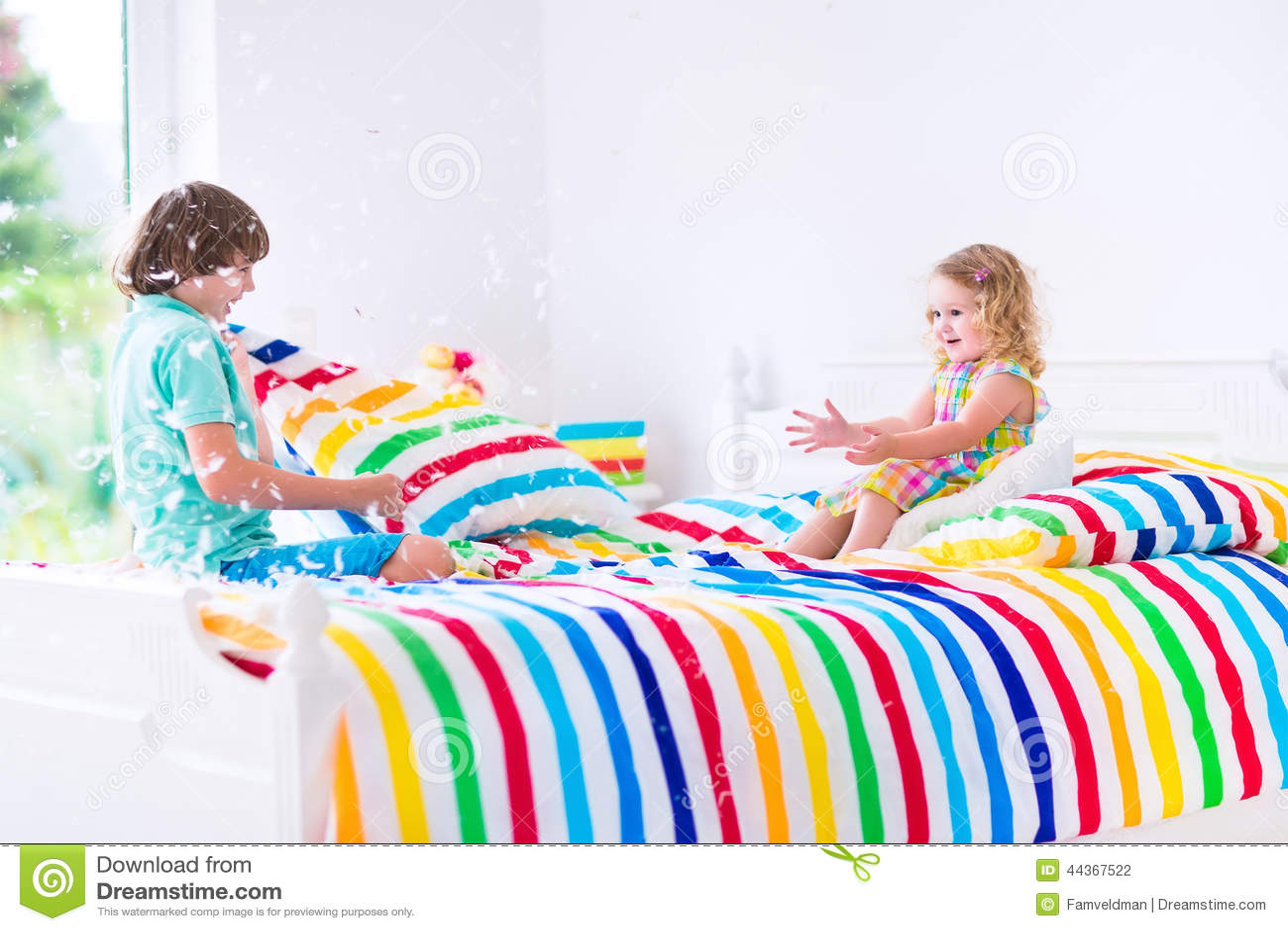 Kids Having Pillow Fight Indoors Little