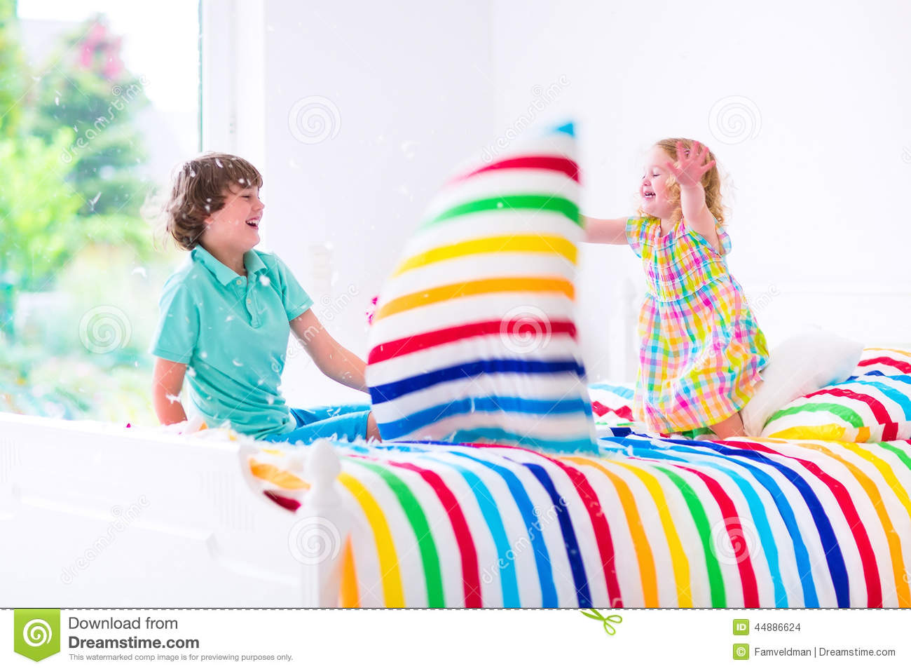 Kids having pillow fight stock photo. Image of furniture ...