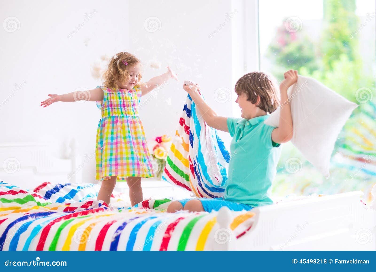 Kids having pillow fight stock photo. Image of little ...