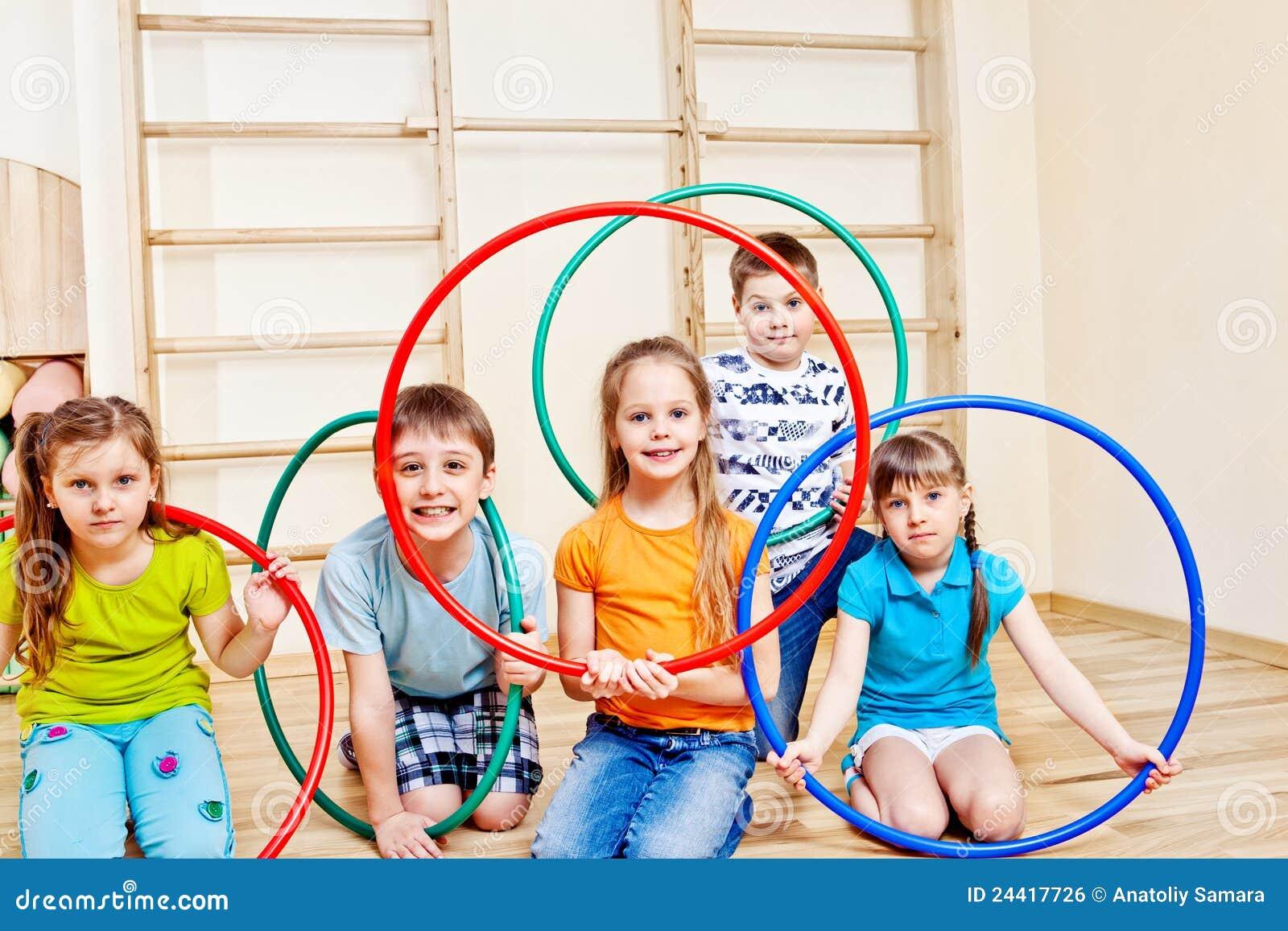 Kids with hula hoops