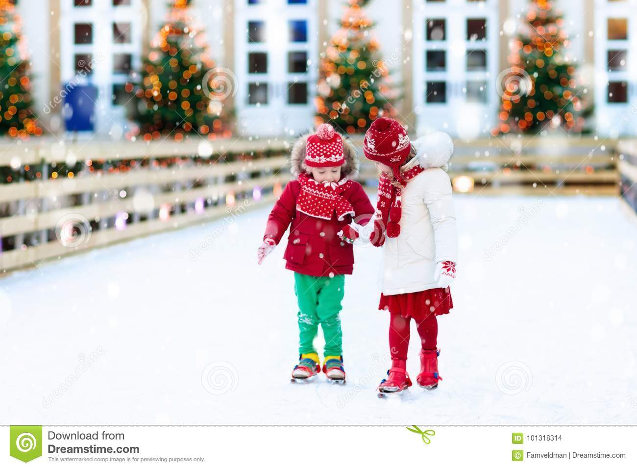 Kids Ice Skating In Winter. Ice Skates For Child. Stock Photo ...
