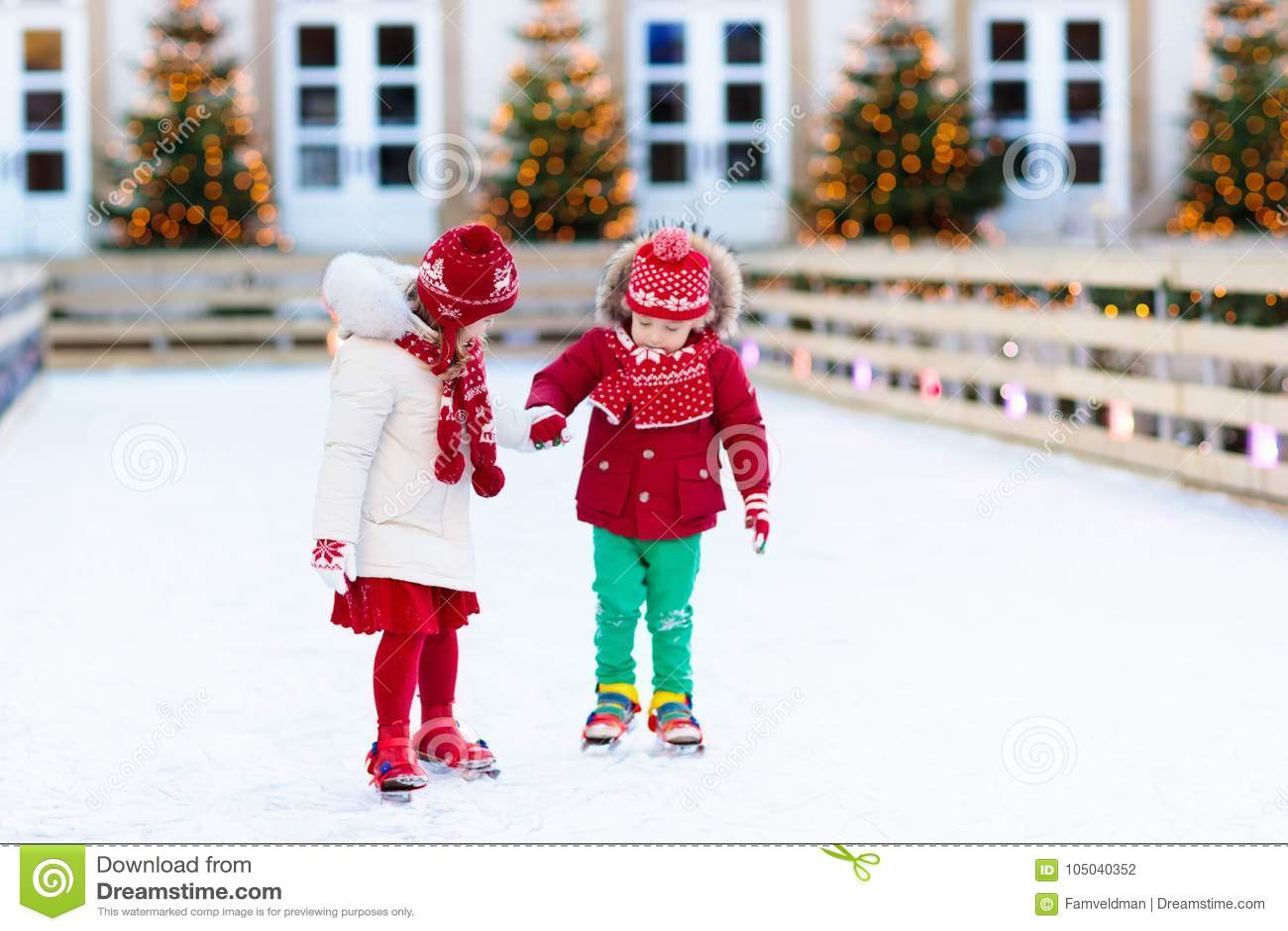 Kids Ice Skating In Winter. Ice Skates For Child. Stock Photo ...
