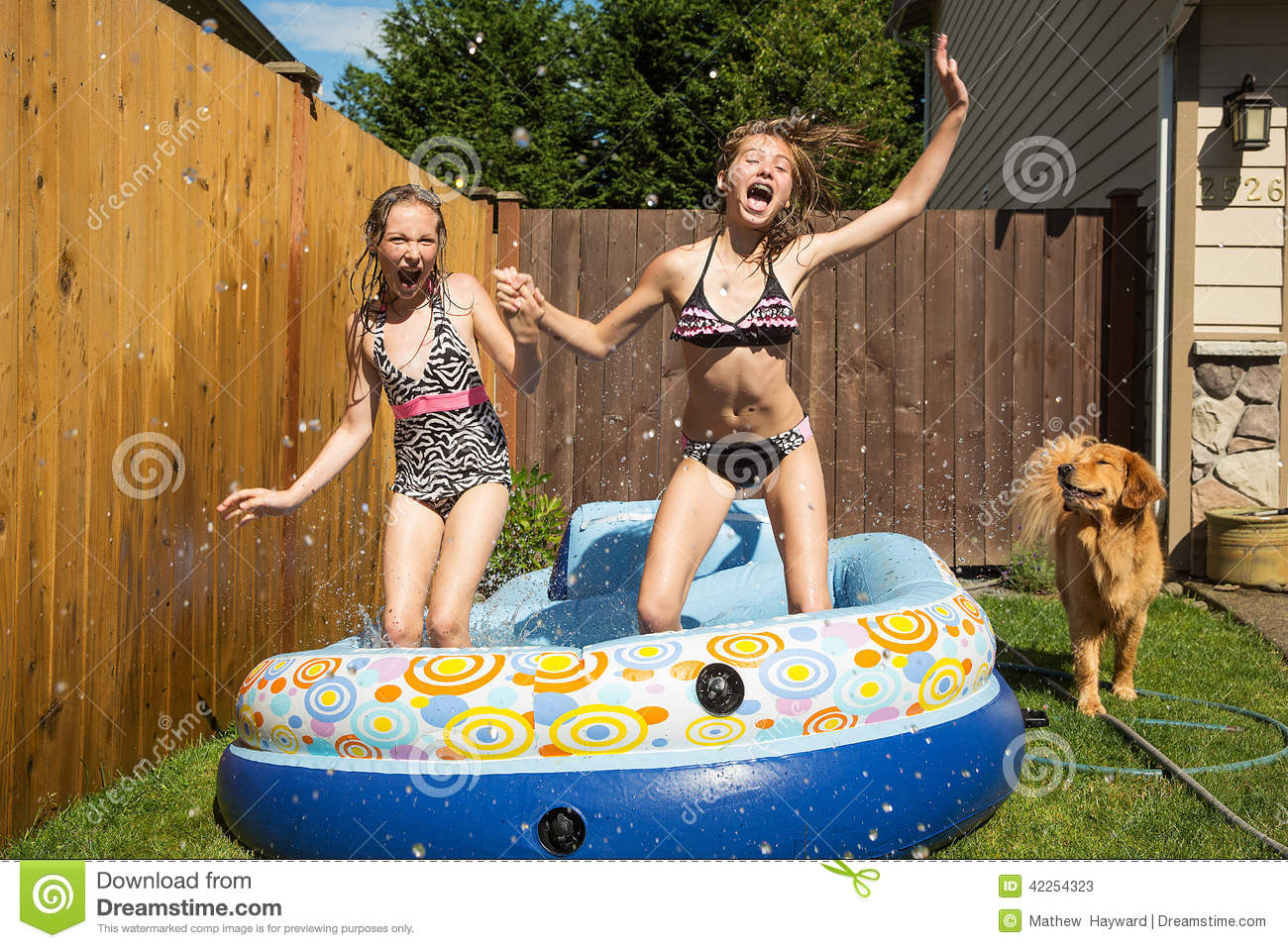 Kids jumping in an inflatable pool stock image image for Best children s paddling pool