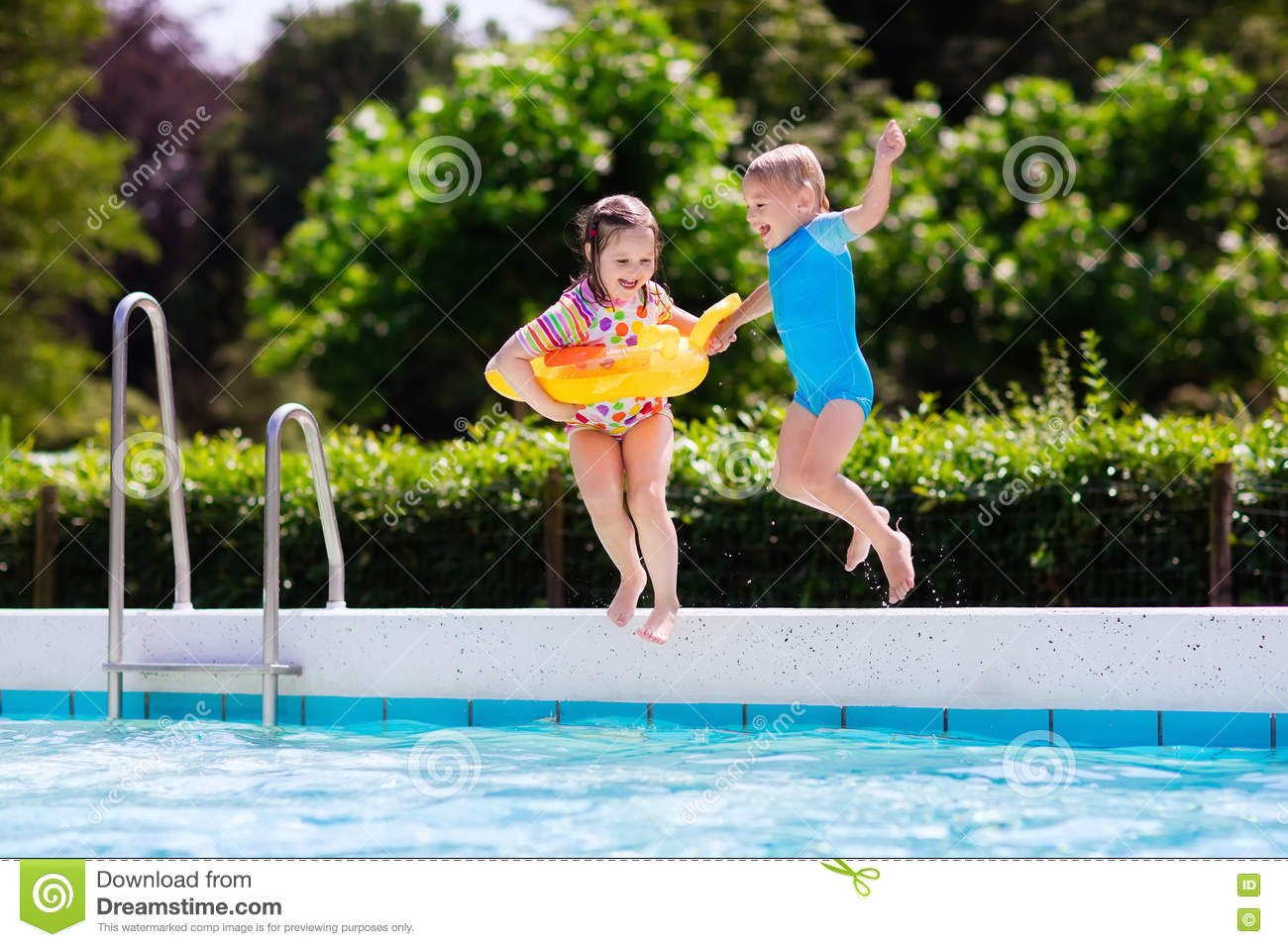 Kids Jumping Into Swimming Pool Stock Photo Image 74930148