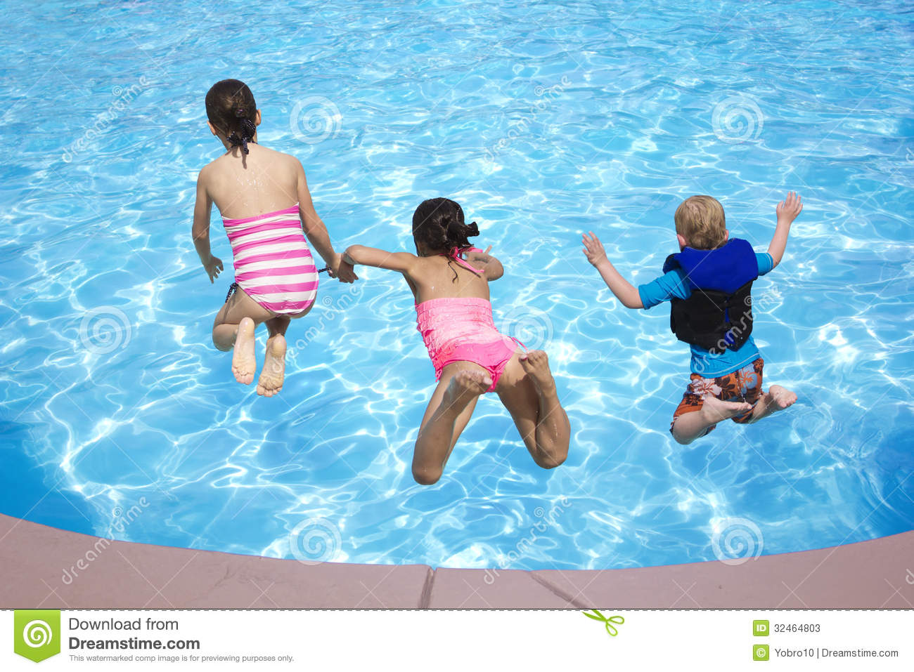 Kids Jumping Into The Swimming Pool Stock Image