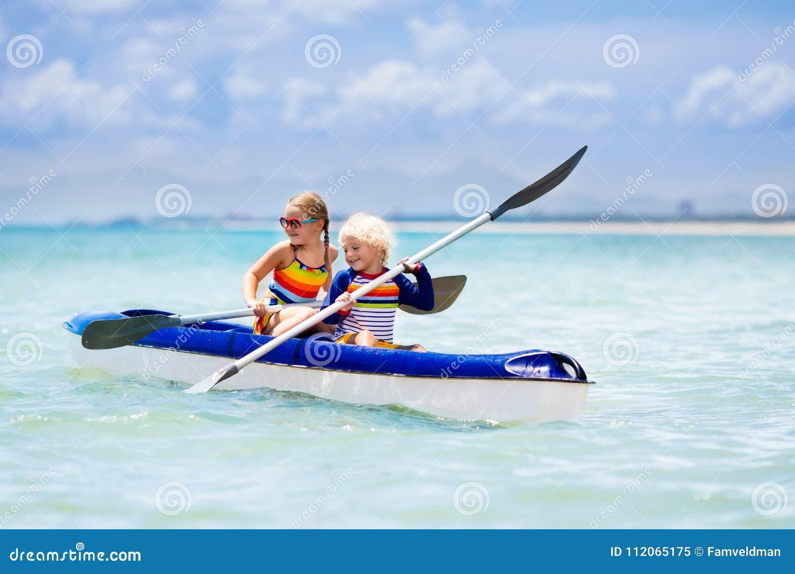 Kids Kayaking In Ocean  Children In Kayak In Tropical Sea