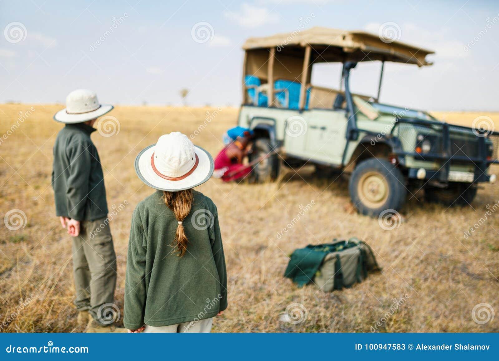 Kids on safari game drive