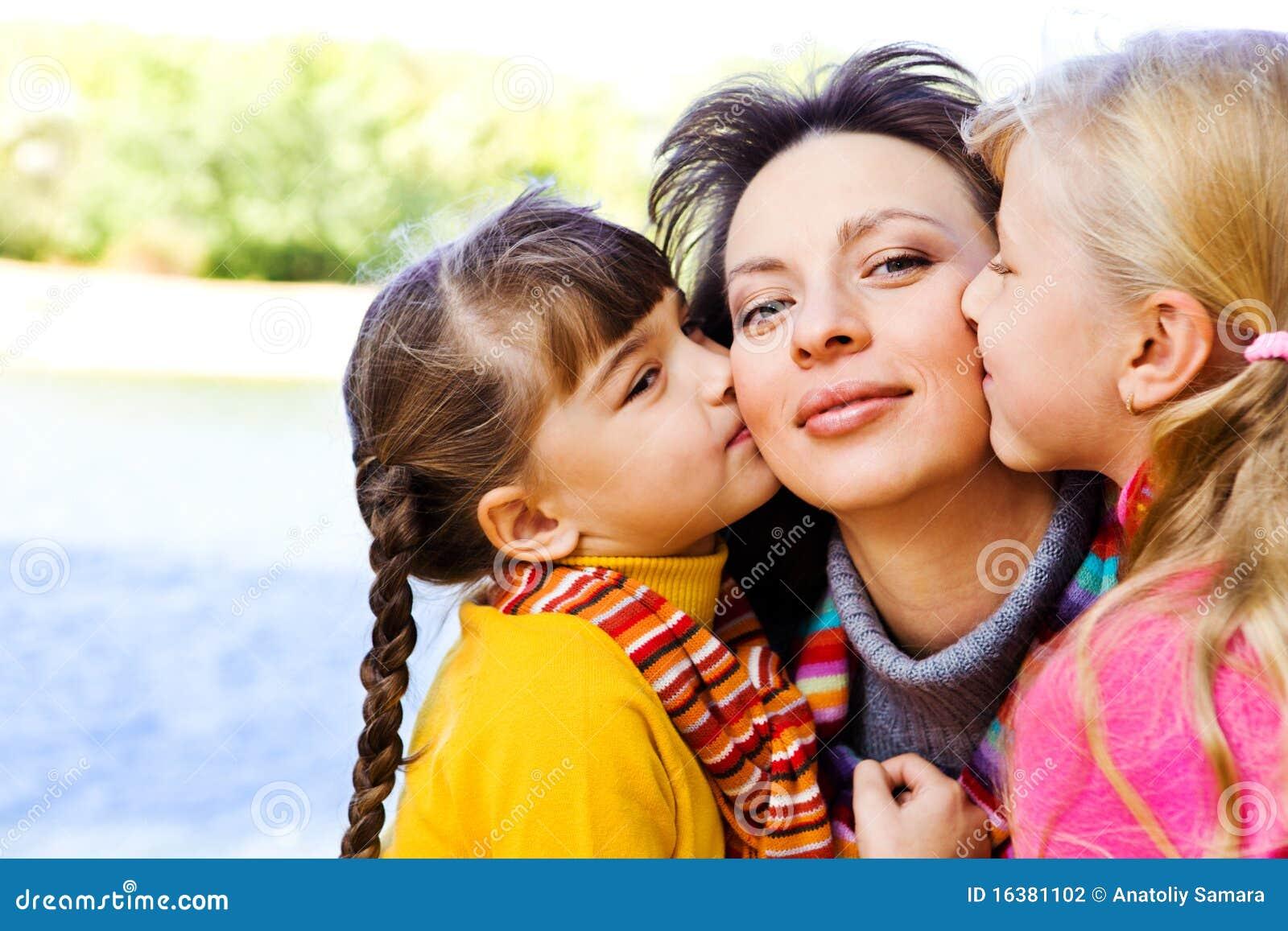 Kids kissing mother
