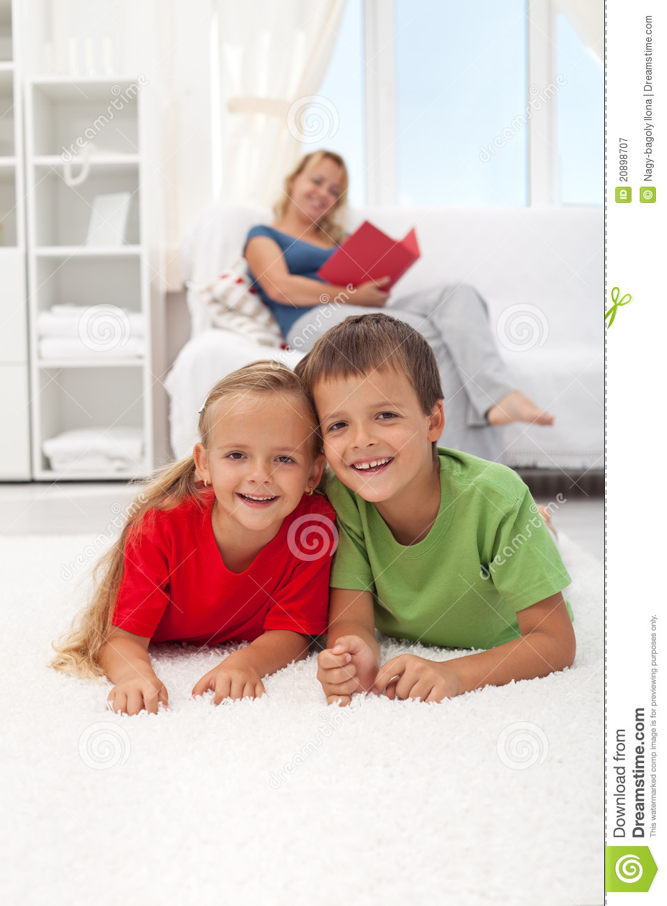 Kids Laying On The Floor In The Living Room Stock Image ...