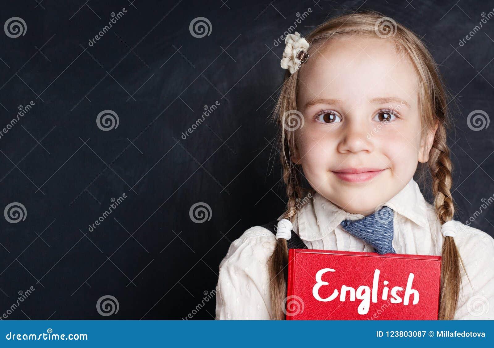 Kids learn english concept. Closeup portrait of cute child girl