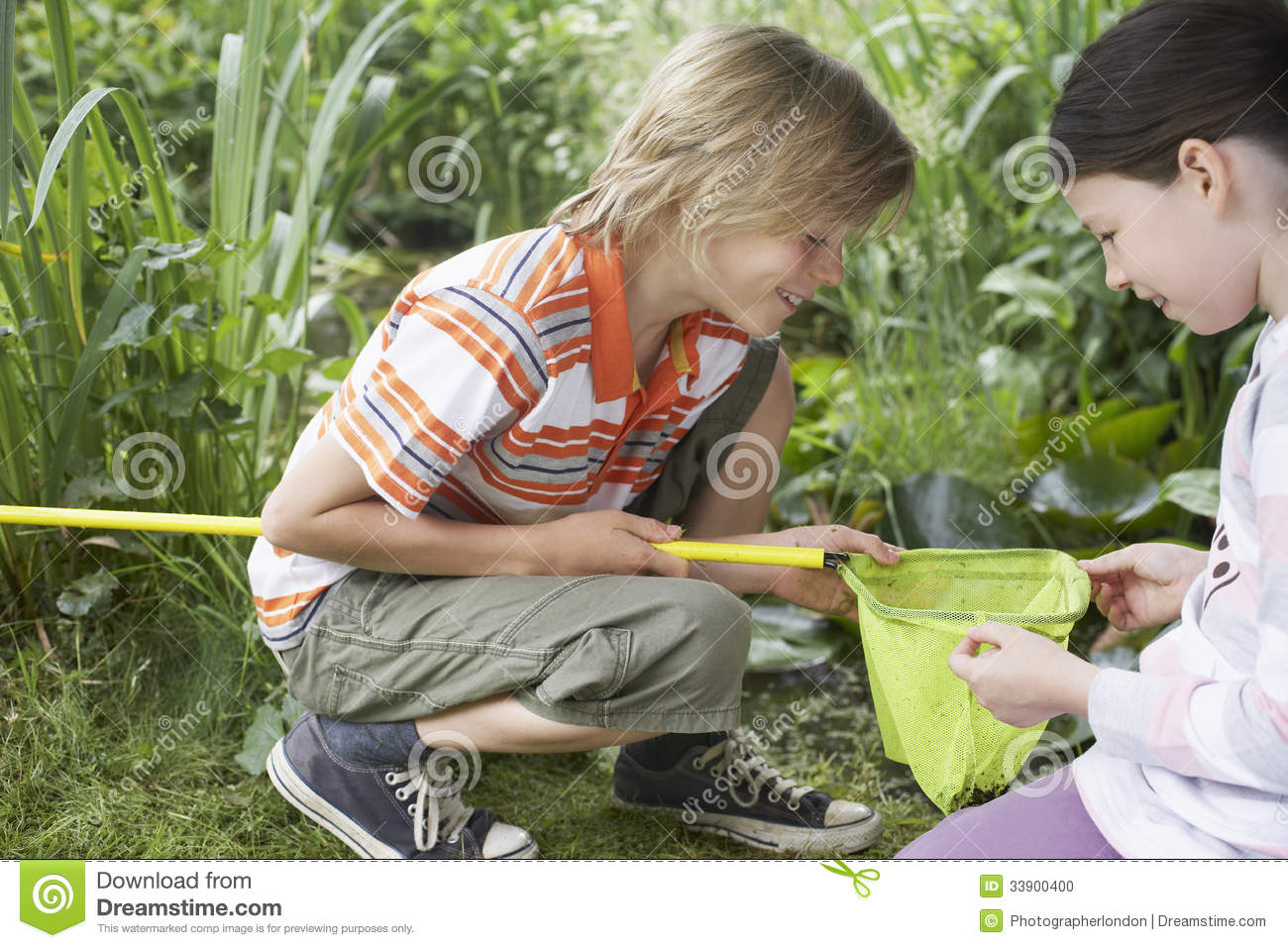 Kids looking into fishing net stock photo image 33900400 for Kids fishing net