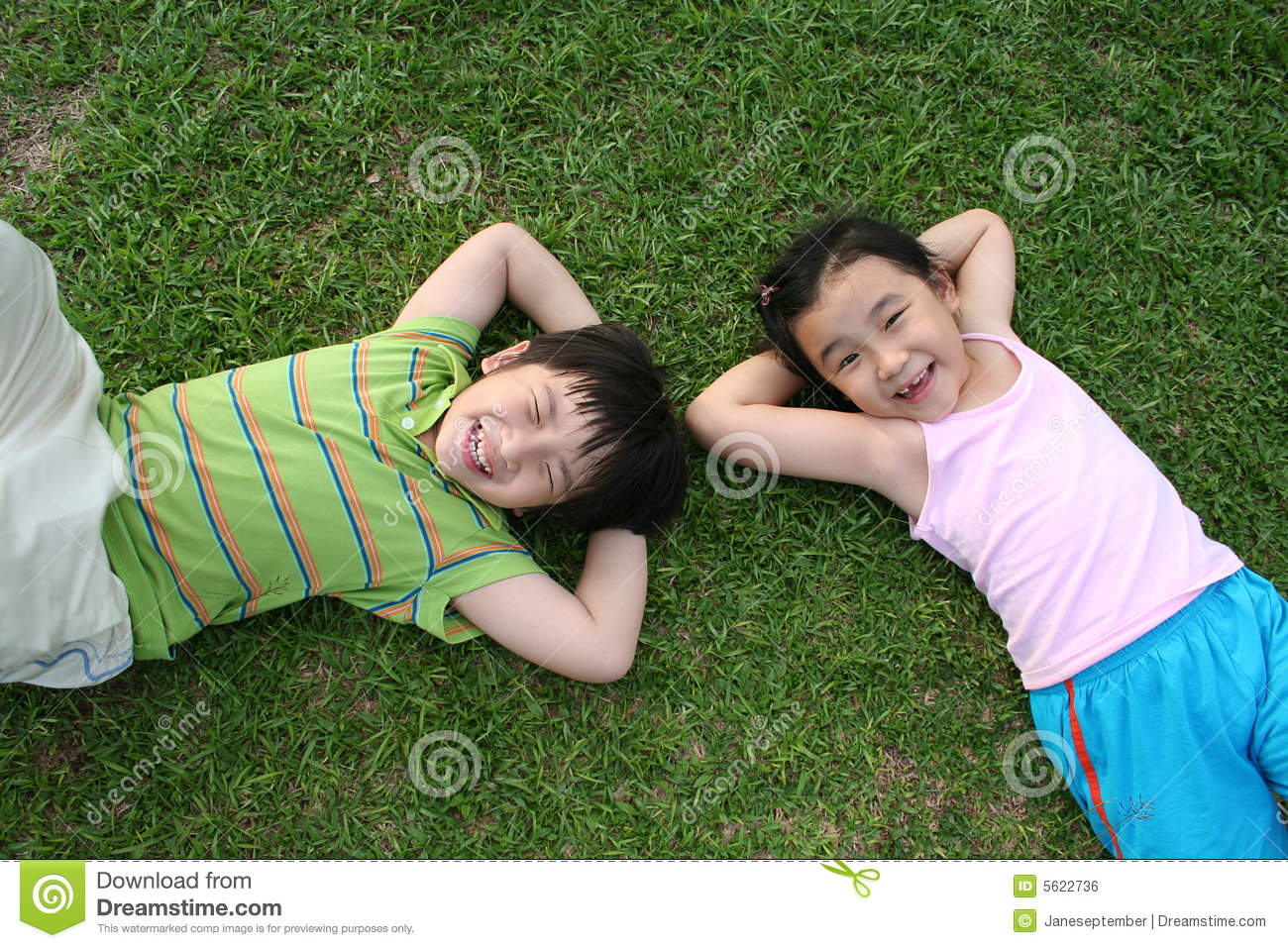 Kids Lying On The Grass Stock Photo Image Of Kids