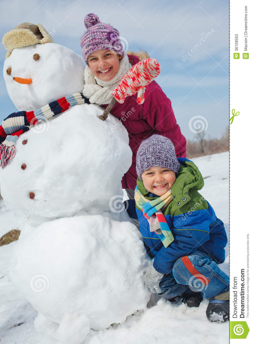 Kids make a snowman stock image image of person park for How to make a snowman