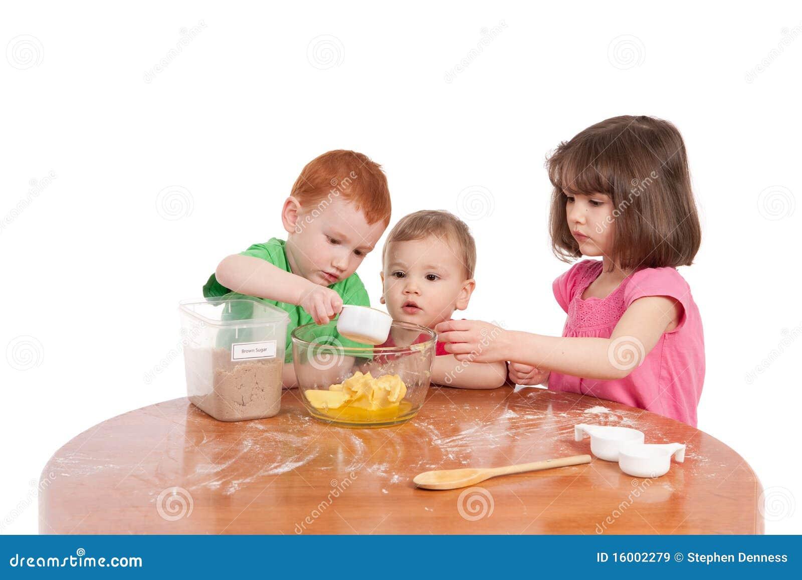 Kids Measuring Ingredients For Baking In Kitchen Royalty