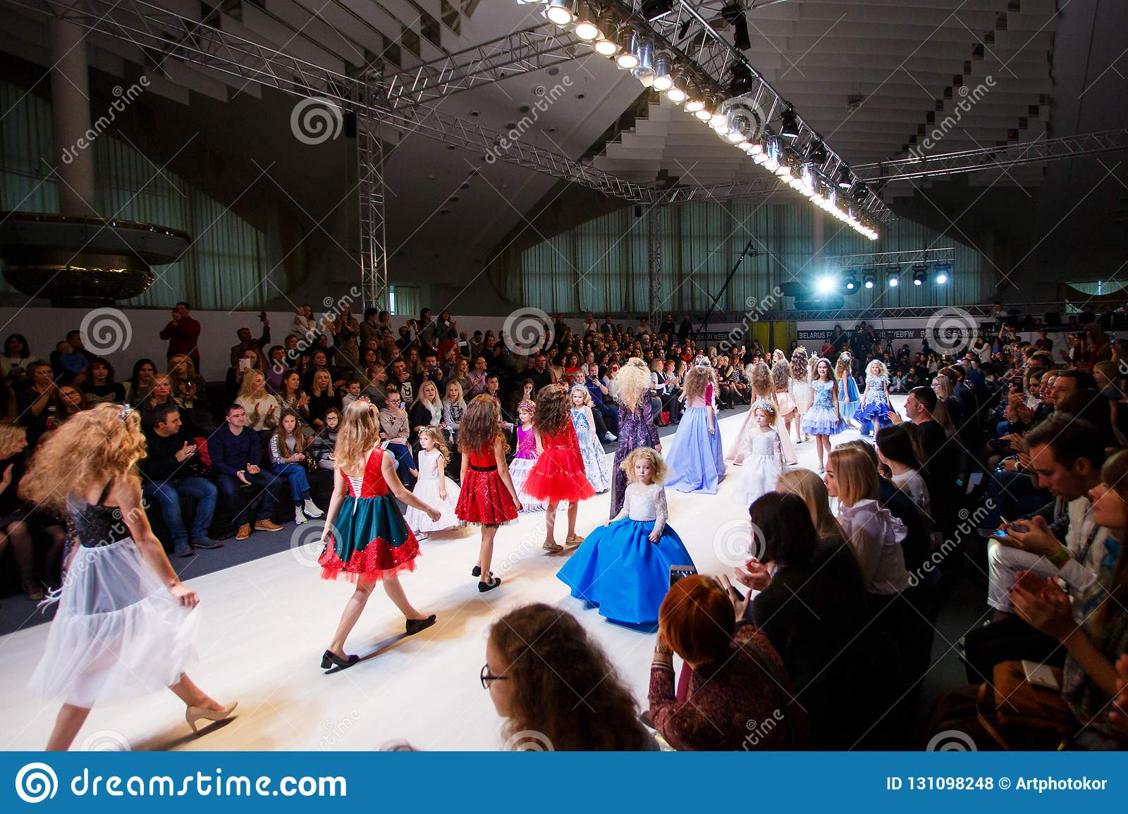 Kids models going down the catwalk at Fashion Week show