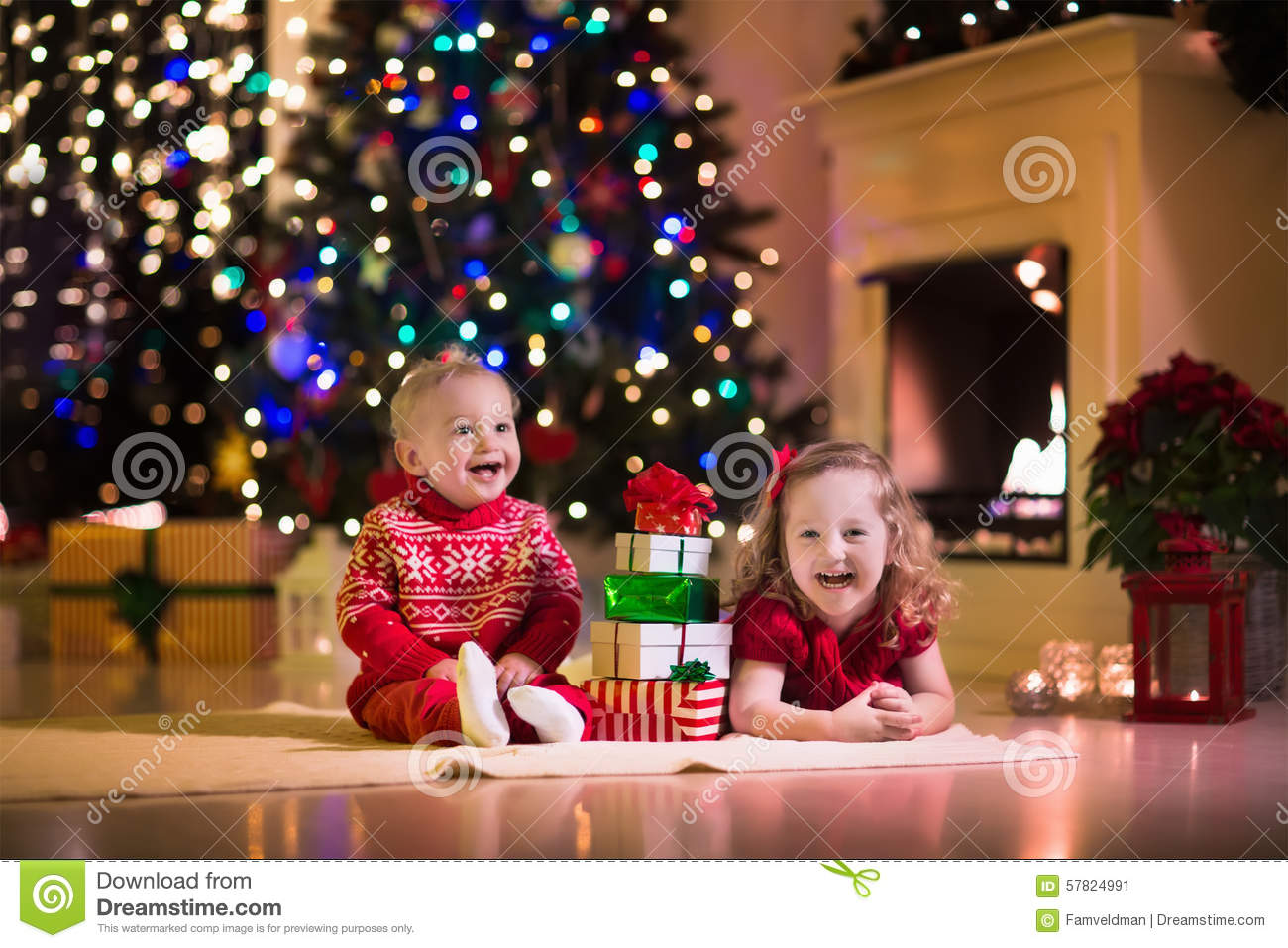 Kids Opening Christmas Presents At Fireplace Stock Image - Image of ...