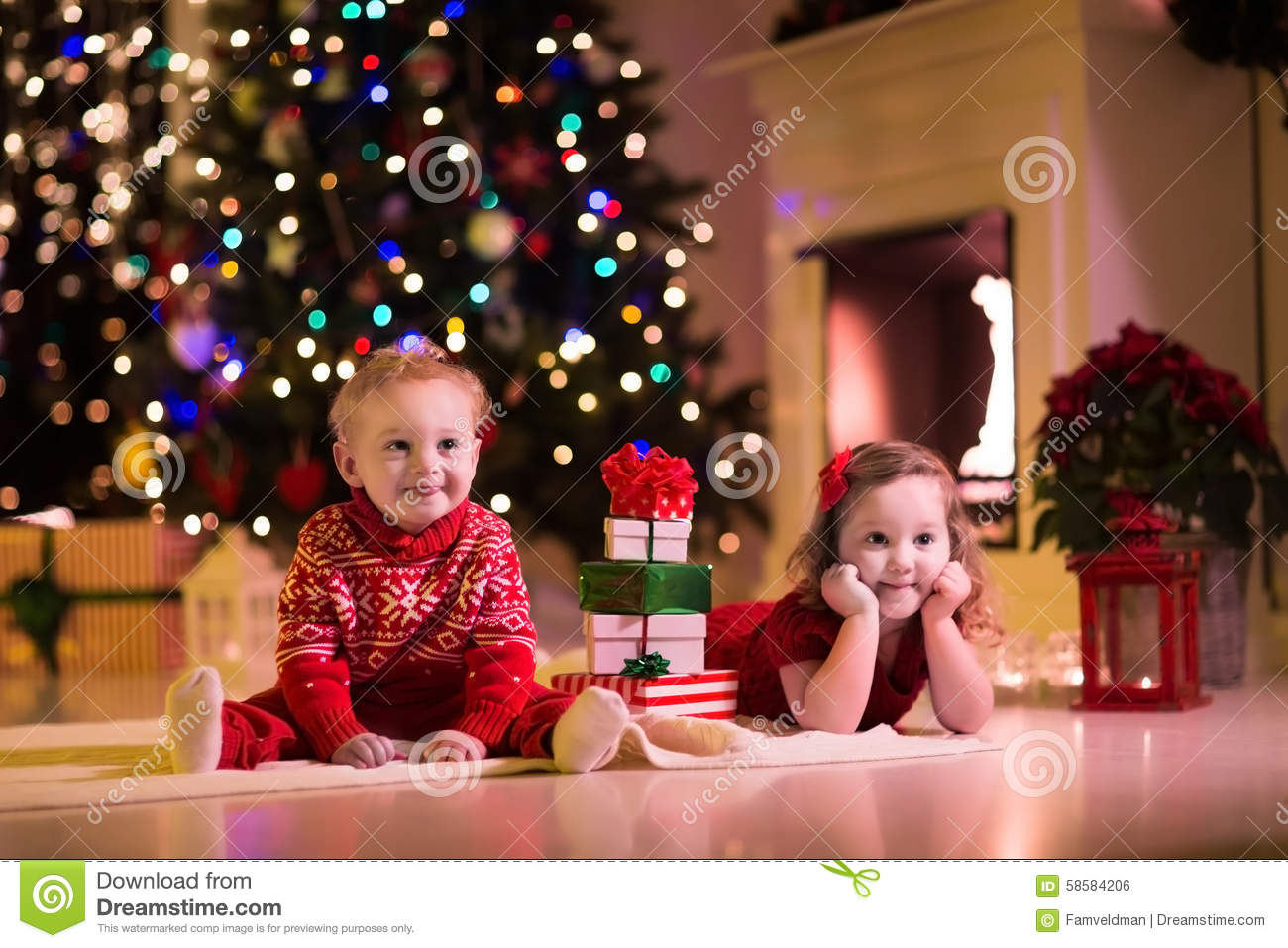 Kids Opening Christmas Presents At Fireplace Stock Photo - Image of ...