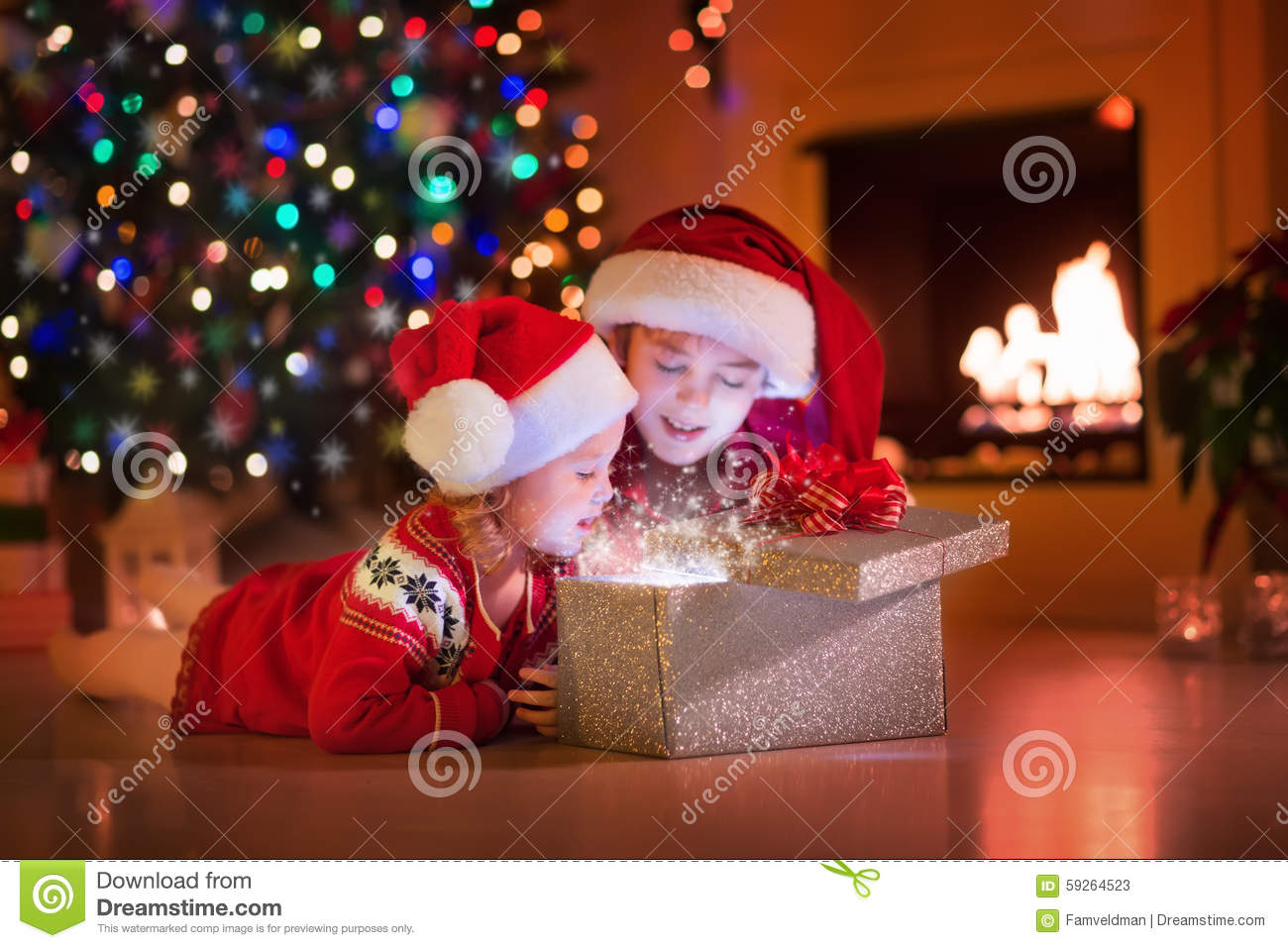 Kids Opening Christmas Presents At Fireplace Stock Photo - Image ...