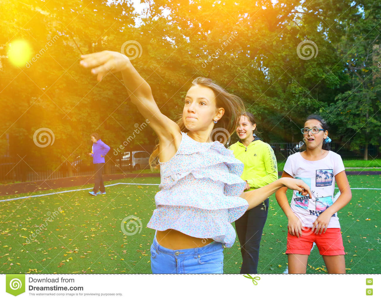 Kids on outdoor sport throwing ball competition