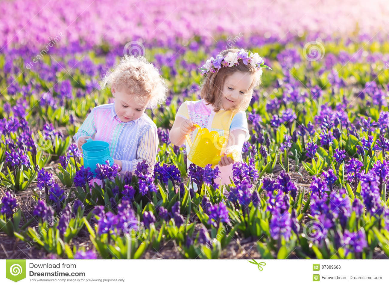 Kids Plant And Water Flowers In Spring Garden Stock Photo Image Of