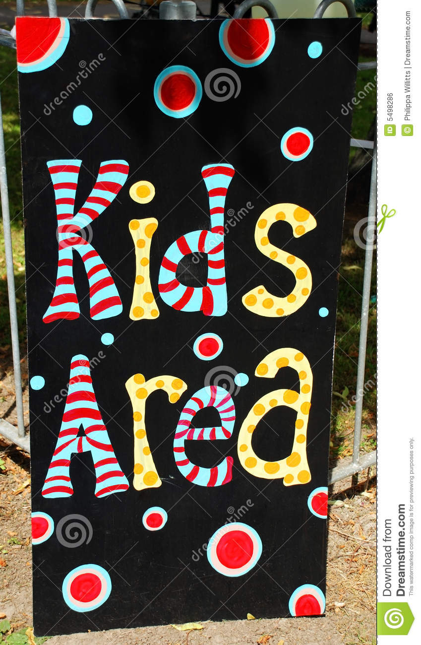 Photograph of a sign for a kids area situated outdoors in front