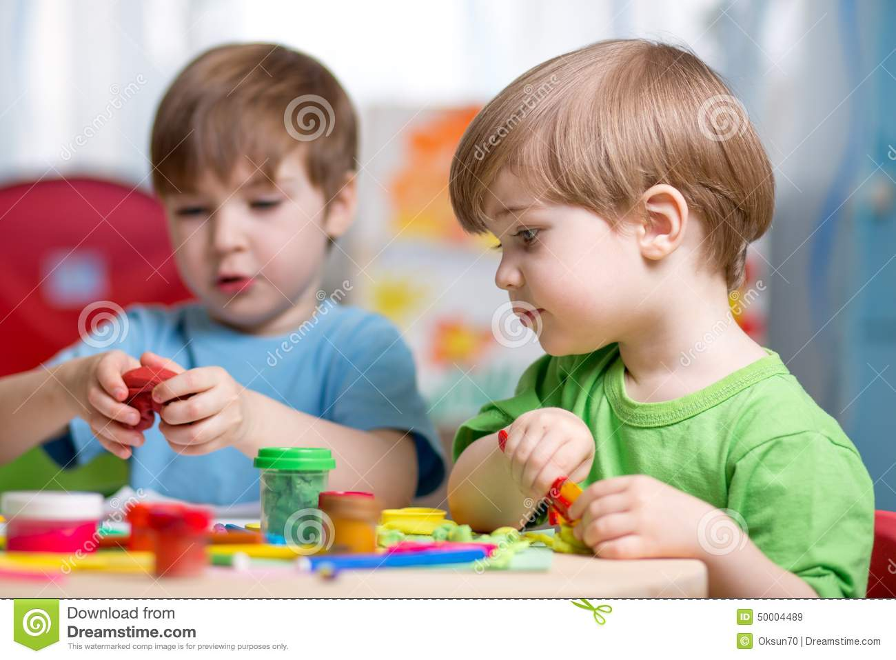 Kinder Garden: Kids With Play Clay At Home Stock Image
