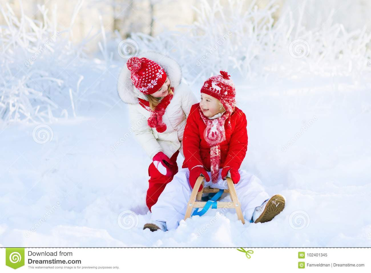 Kids Play In Snow Winter Sleigh Ride For Children Stock Image
