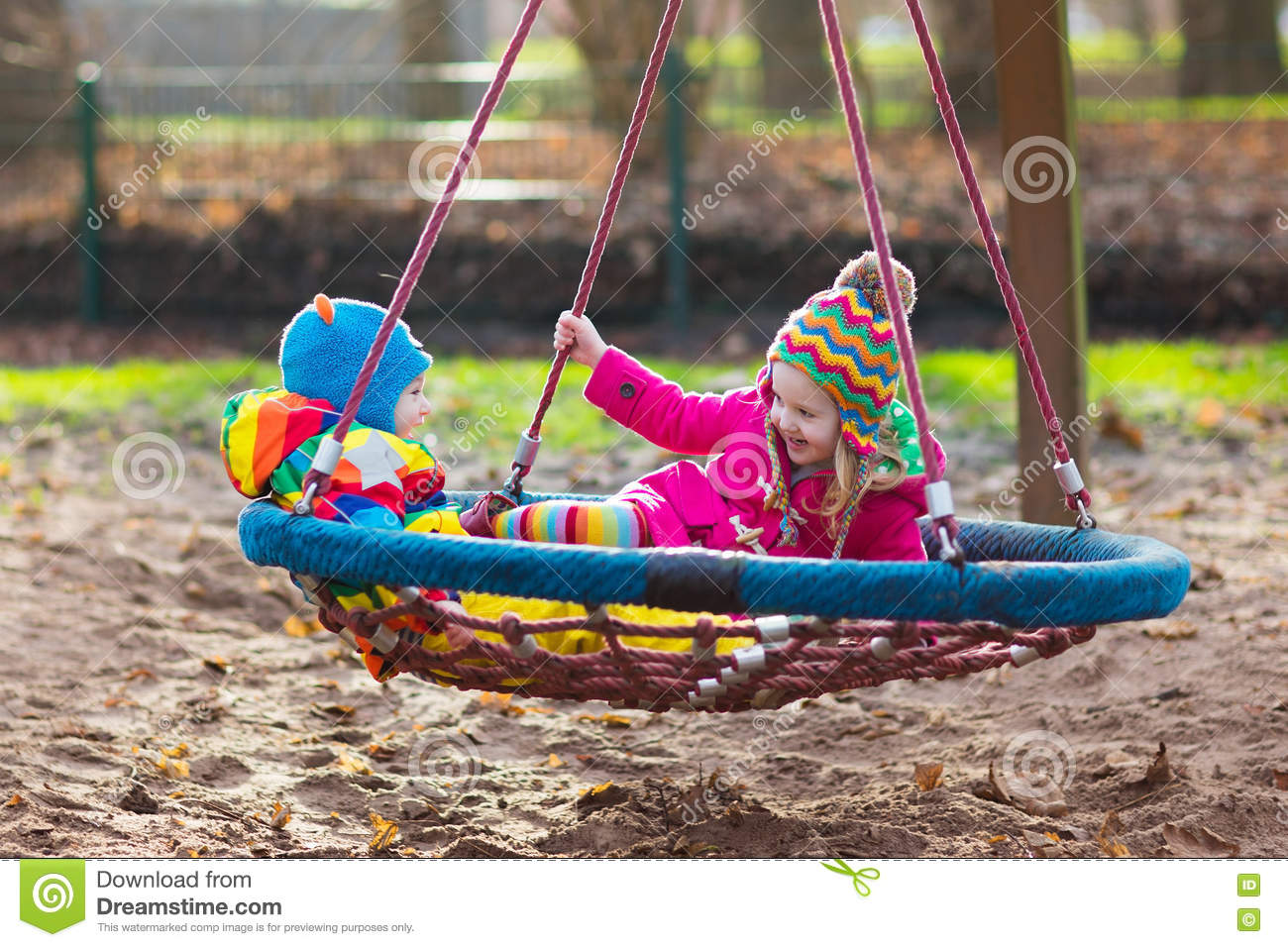 Kinder Garden: Kids On Playground Swing Stock Photo. Image Of Amusement