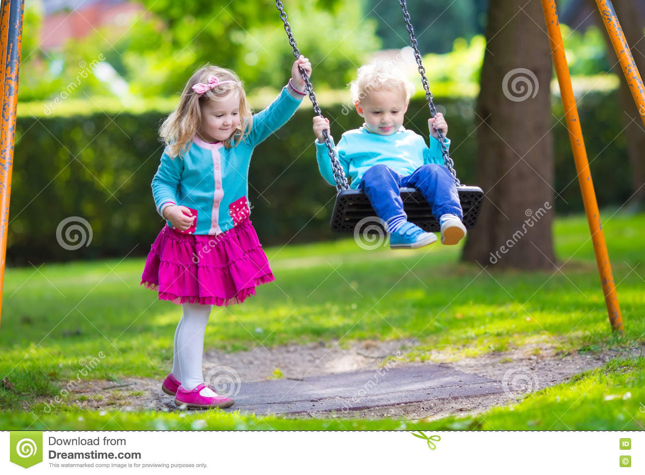 Kids on playground swing stock photo image of happiness for Childrens play yard