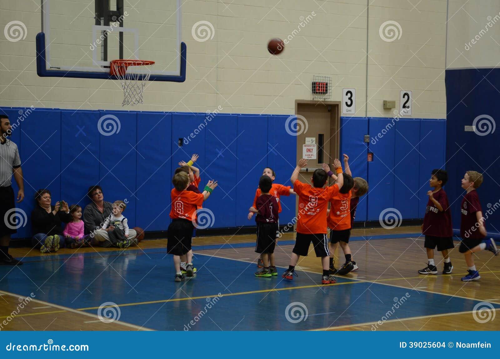 A Woman Playing Basketball Imágenes De Stock A Woman: Kids Playing Basketball Editorial Stock Image