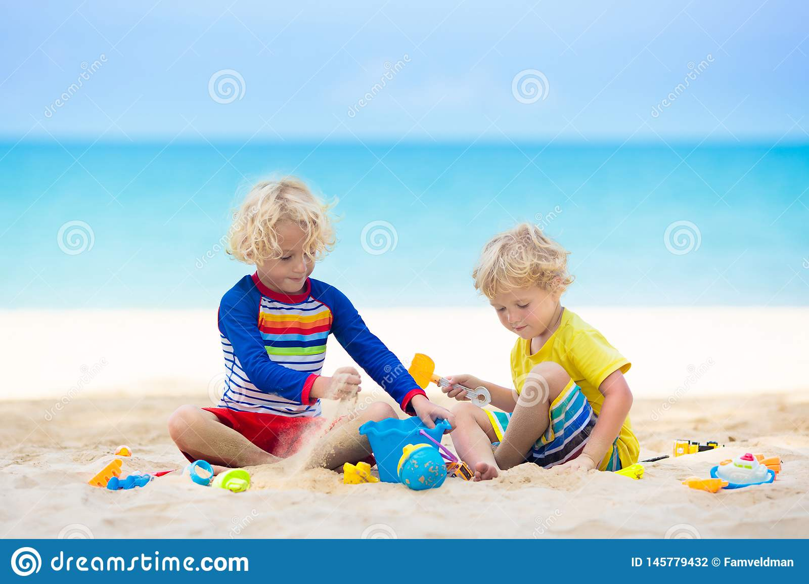 Kids playing on beach. Children play at sea