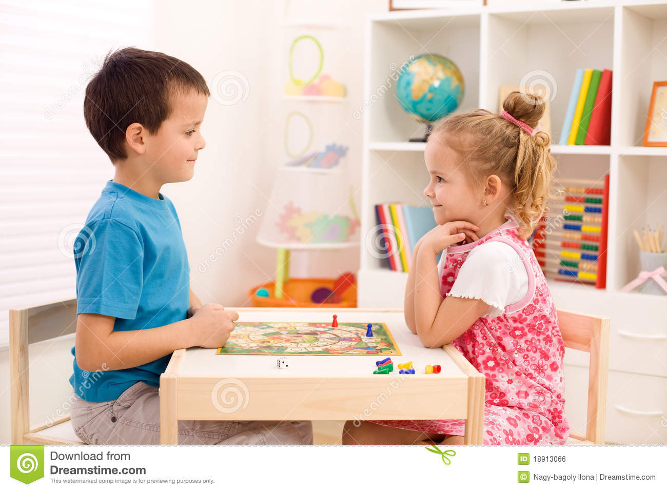 Kids Playing Board Game In Their Room Royalty Free Stock
