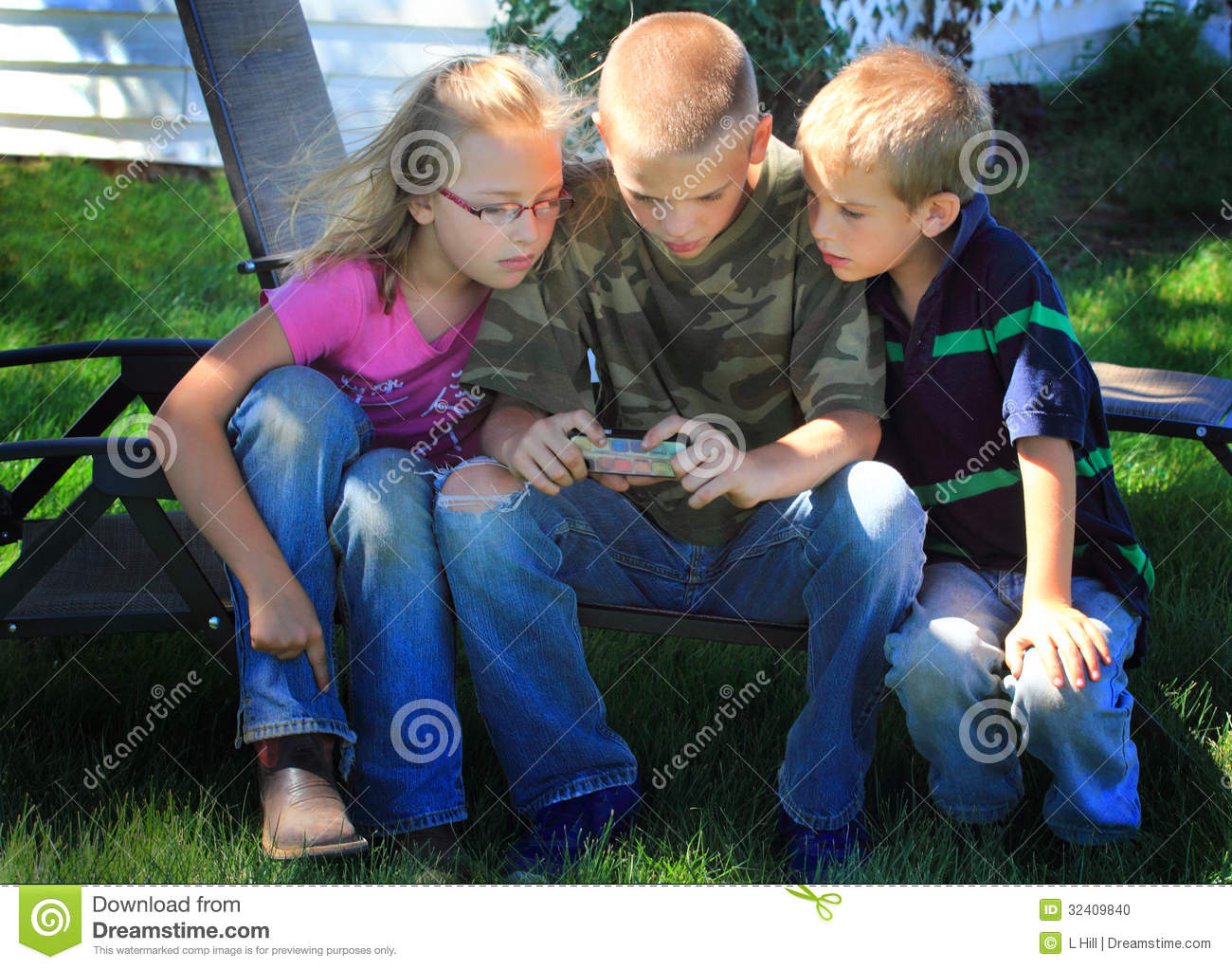 Kids playing on cell phone