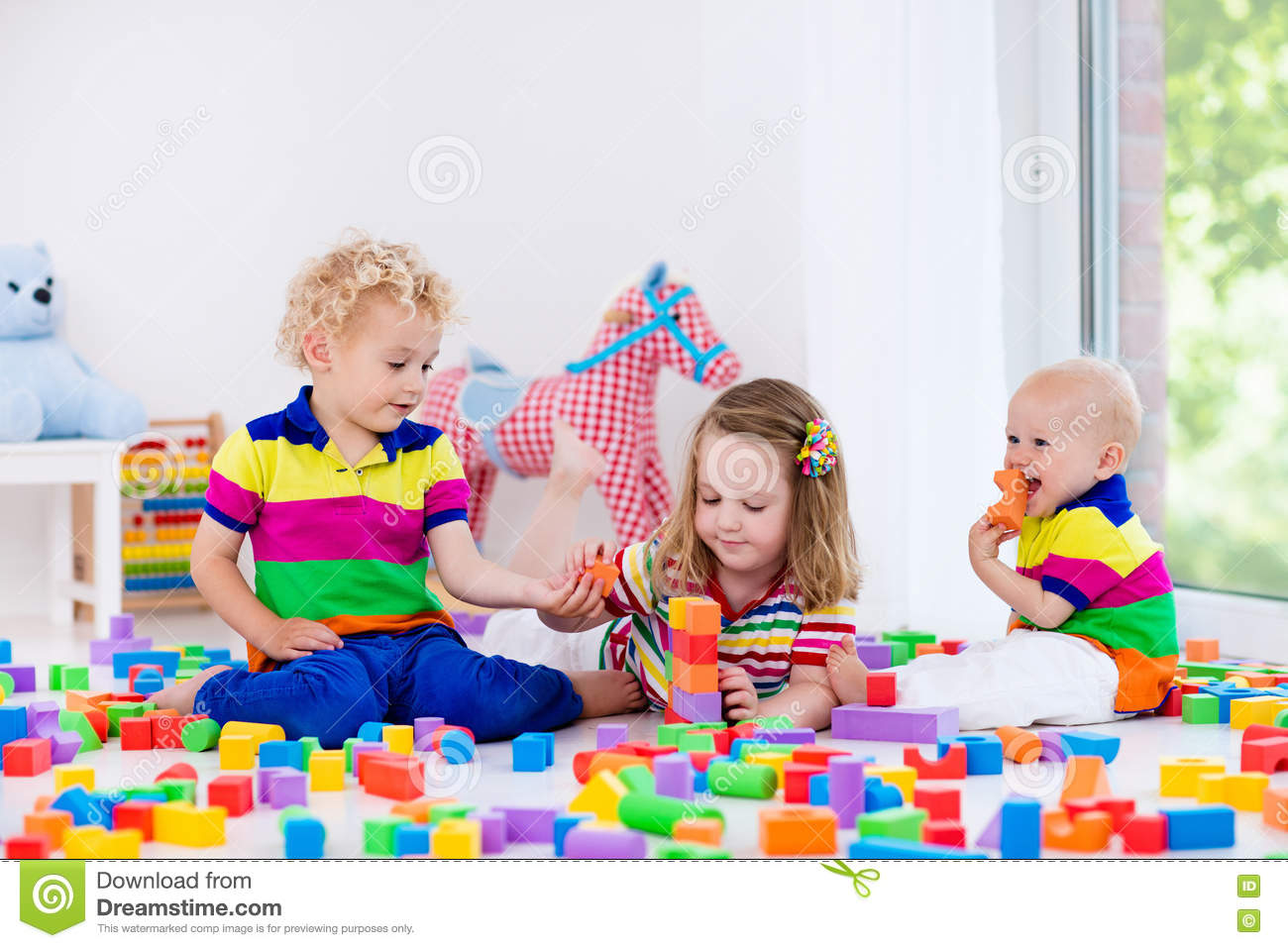 Kids Playing With Colorful Toy Blocks Stock Photo Image Of Mess