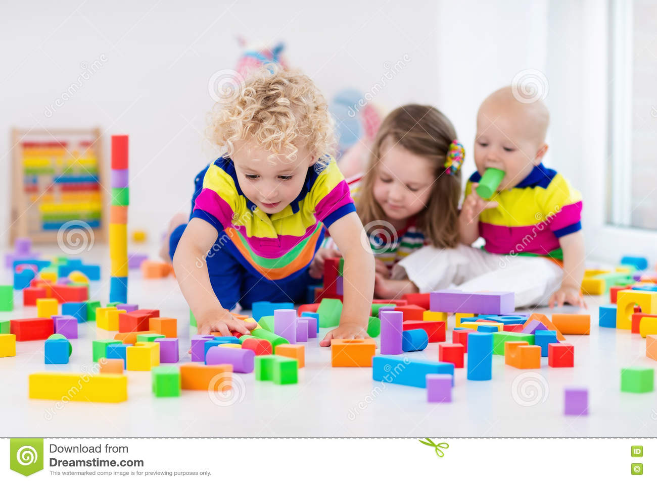 Childcare Floor Plans Kids Playing With Colorful Toy Blocks Stock Photo Image