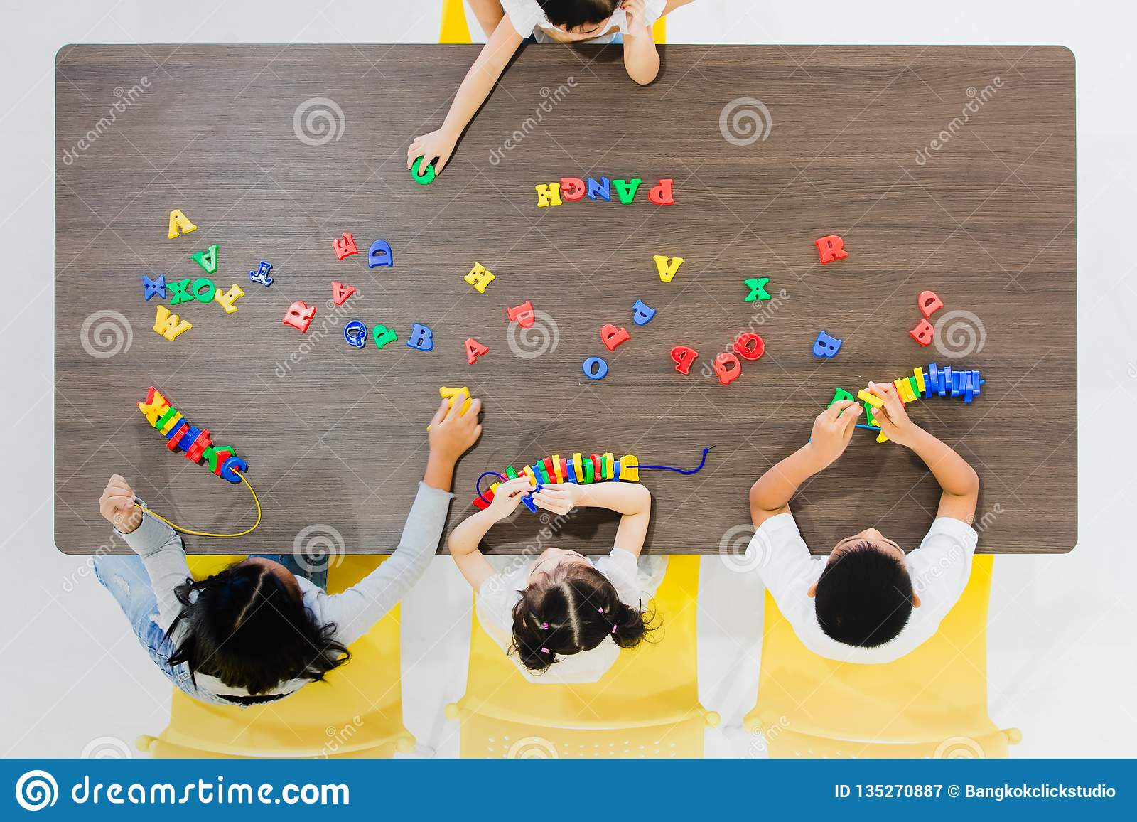 Kids playing colorful toys