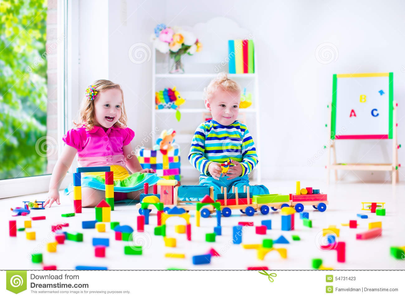 ... tower of colorful wooden blocks. Child playing with toy train