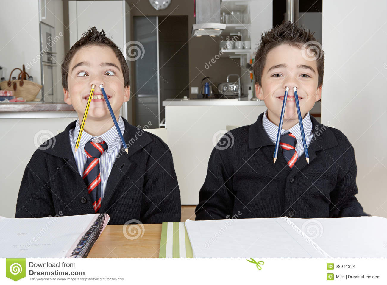Kids Playing While Doing Homework At Home Stock Images