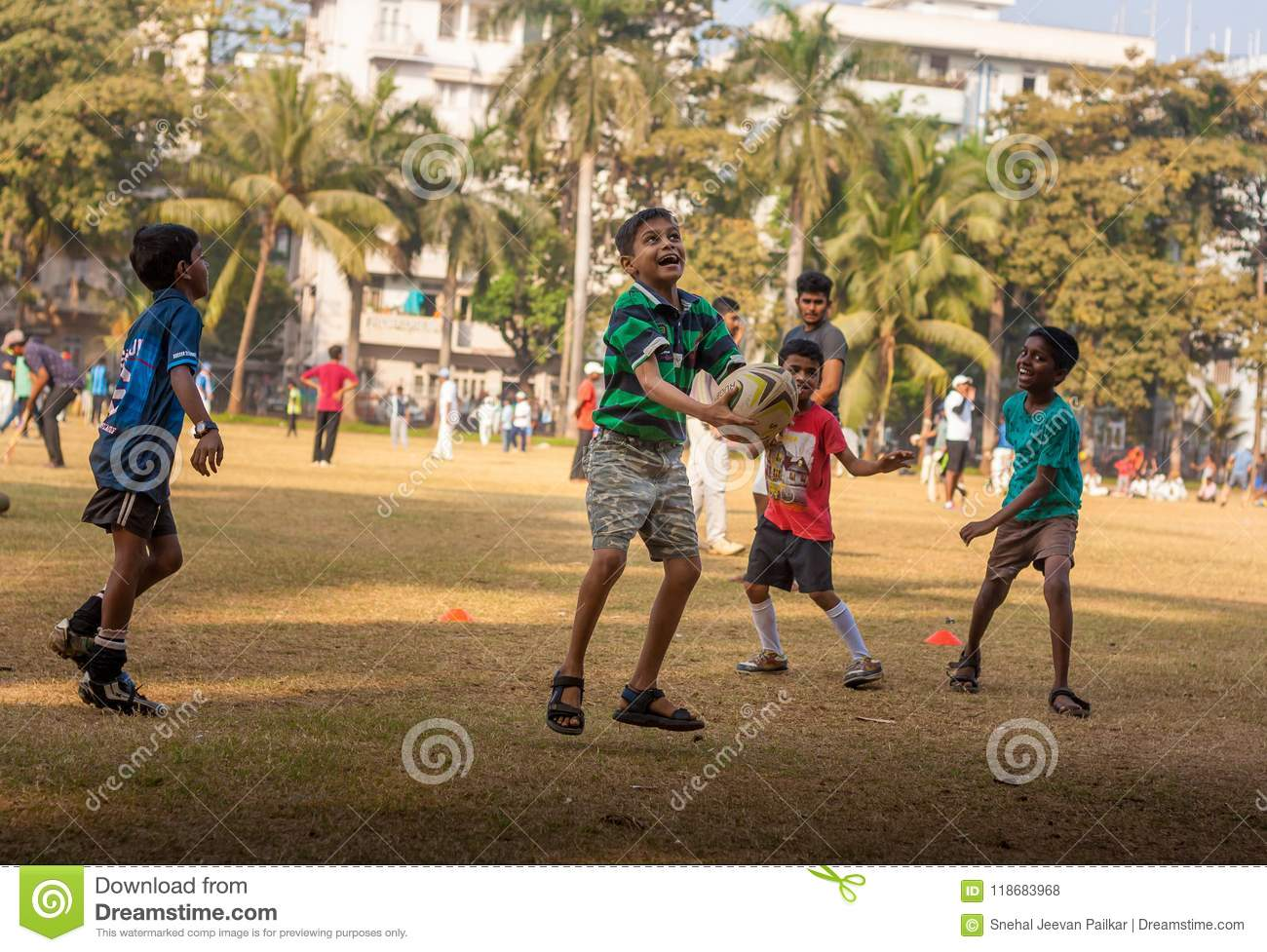 Kids playing football at Mumbai ground