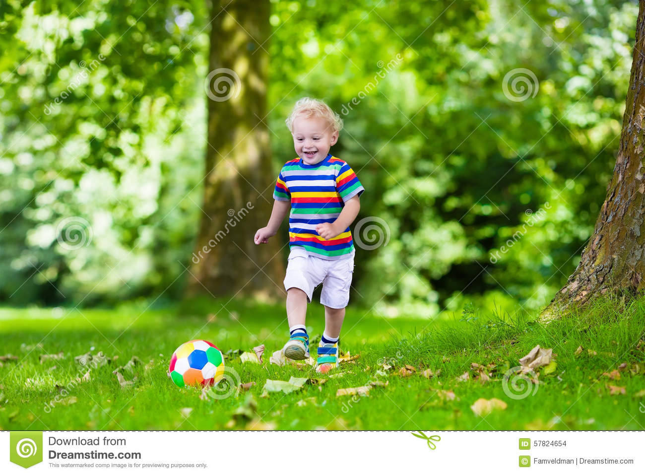 child playing european football outdoors in school yard kids play