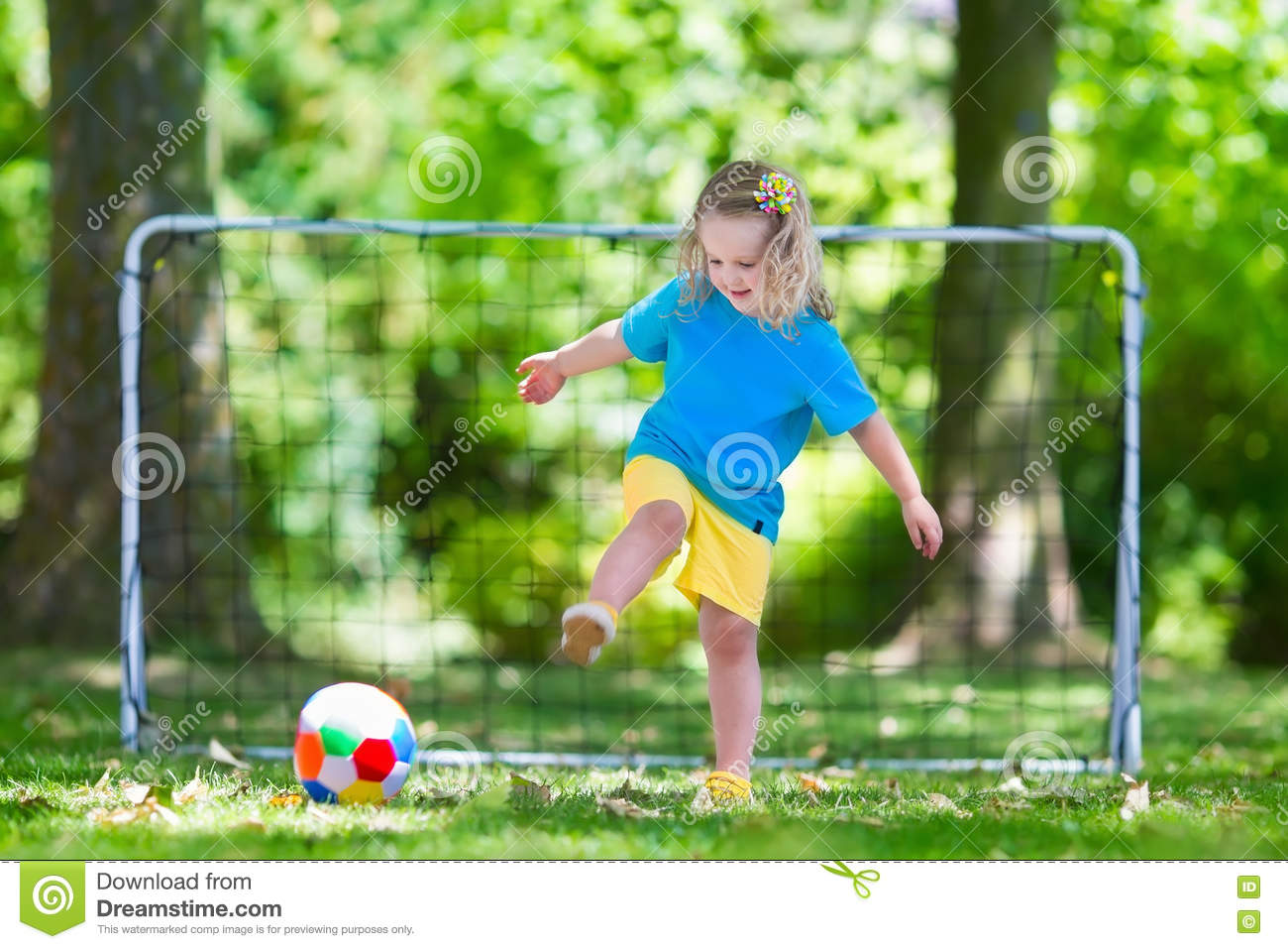 Kids playing football in school yard stock photography for Childrens play yard
