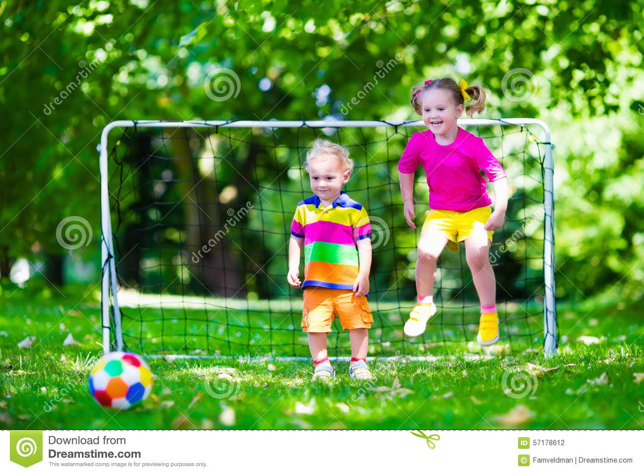 Kids playing football in school yard stock image for Childrens play yard